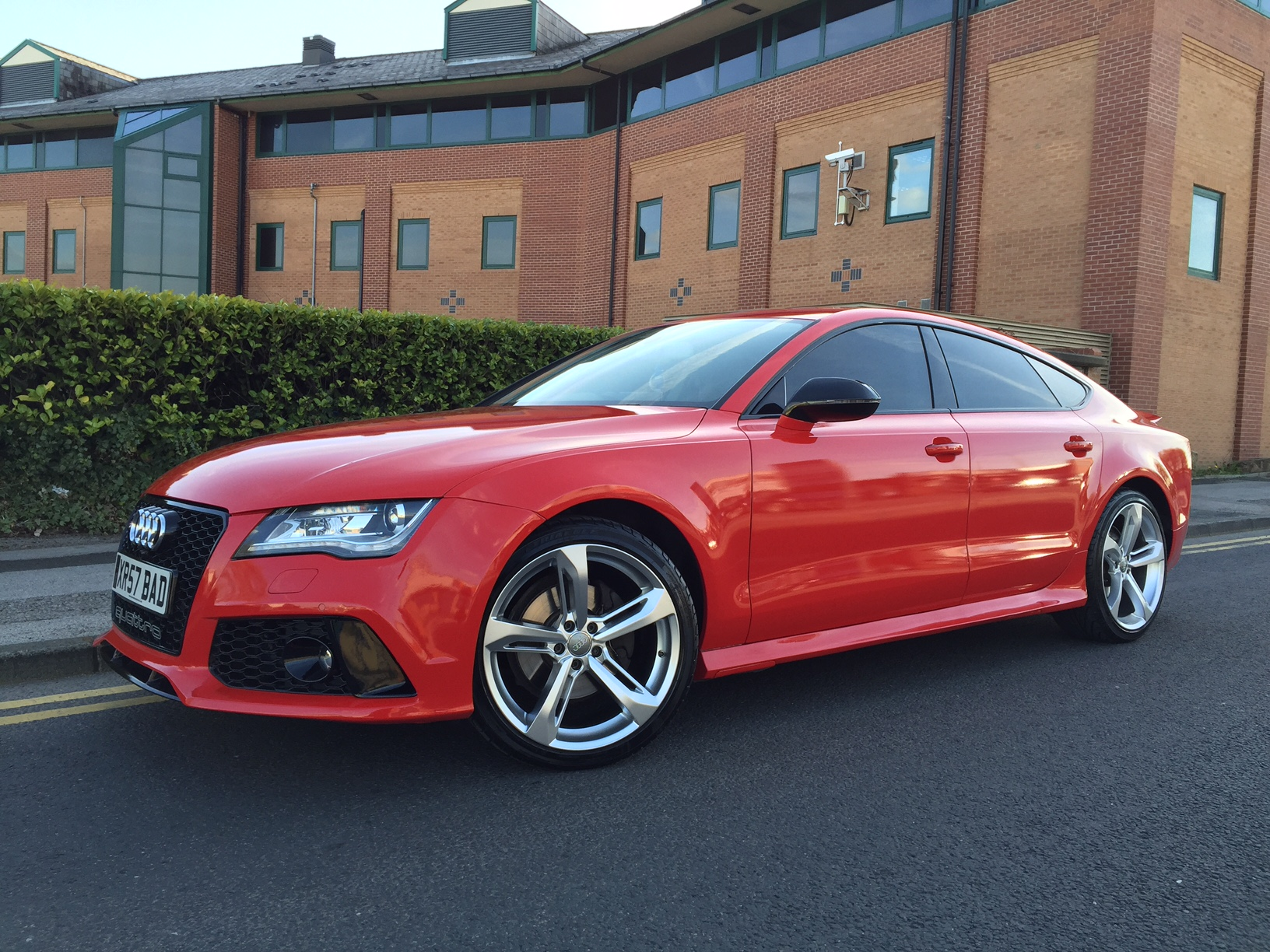 Audi A7 RS7 styling conversion wrapped in red